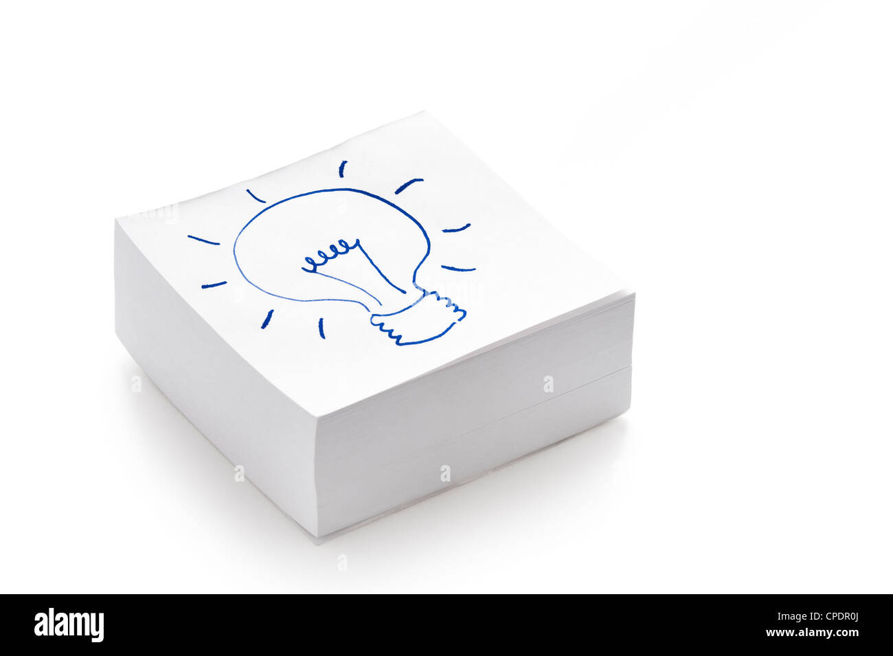 lightbulb drawing on a stack of post it notes illustrating the concept of having an idea - Stock Image