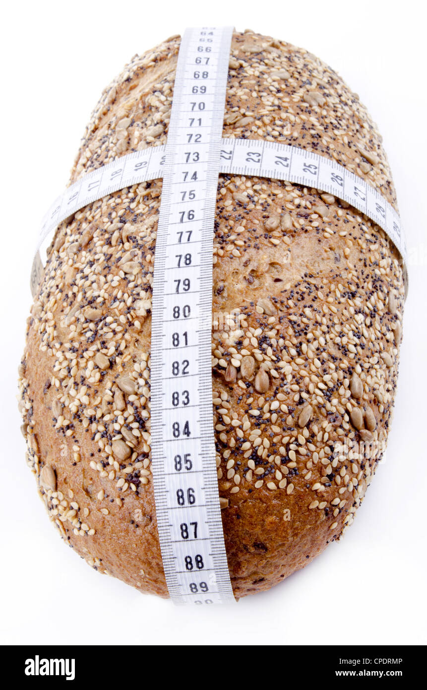 multigrain bread with centimeter measuring tape - Stock Image