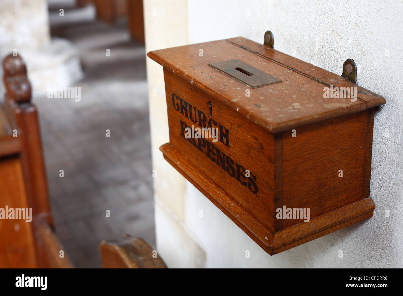 Wooden box marked 'CHURCH COLLECTIONS' at Shernborne church in Norfolk. - Stock Image