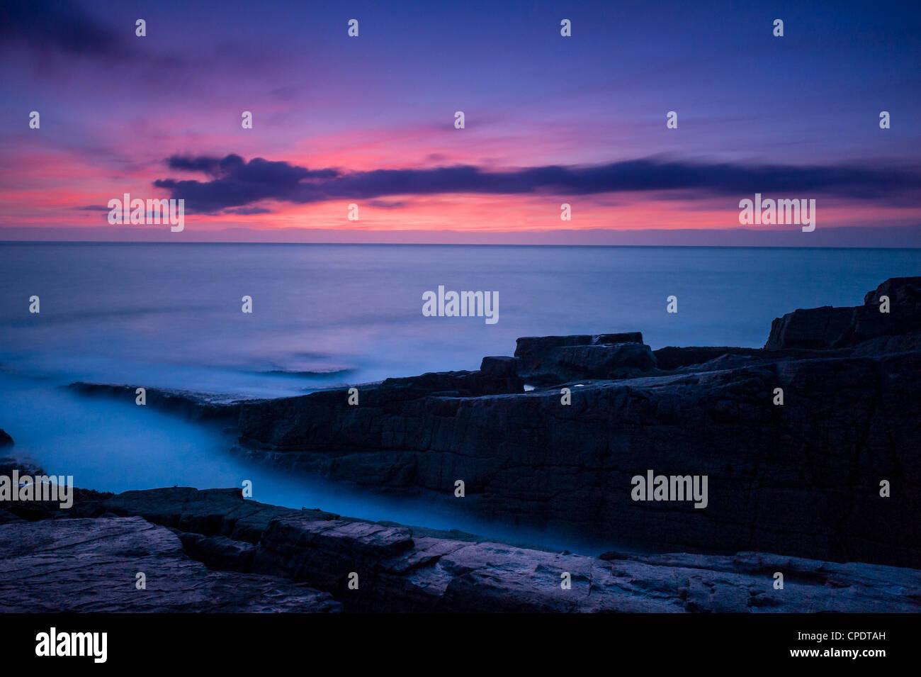 Looking out towards Isle of Lewis from Stoer Lighthouse at dusk, Highlands, Scotland, UK Stock Photo