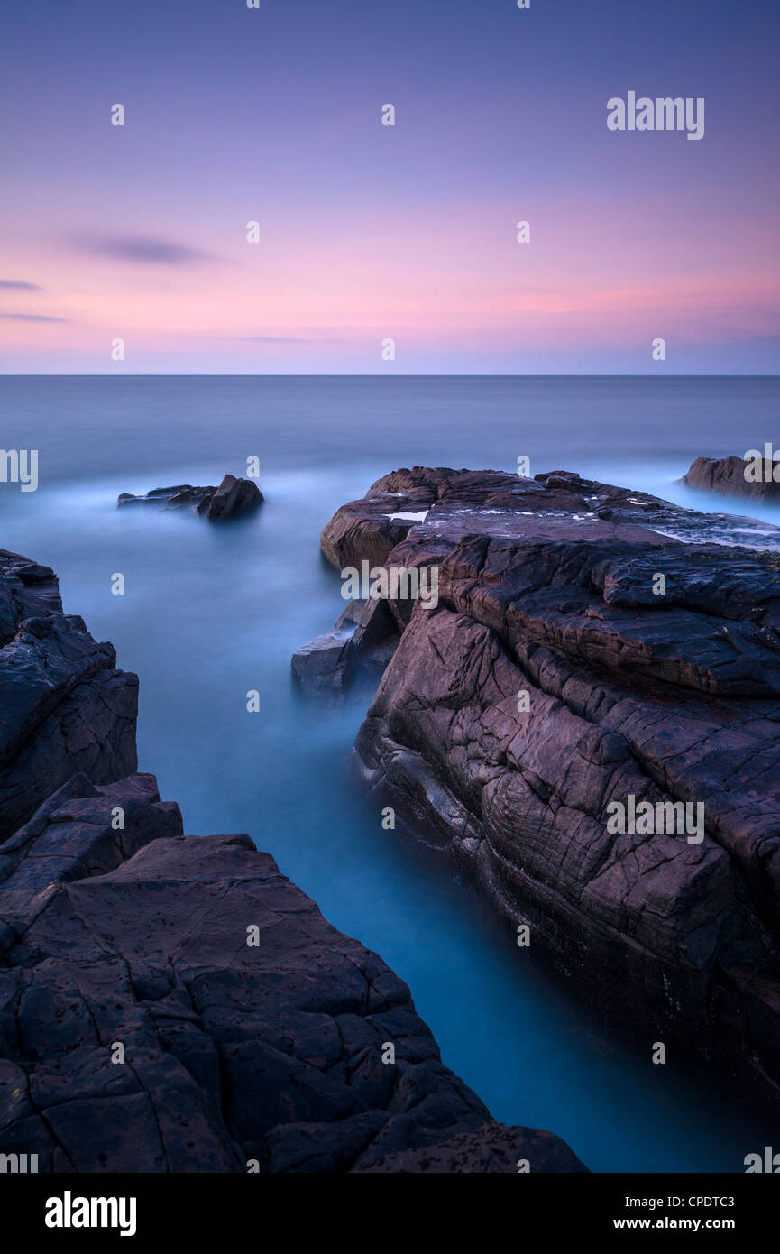 Rocks looking out to sea from the point of Stoer at dawn, Scotland, UK Stock Photo