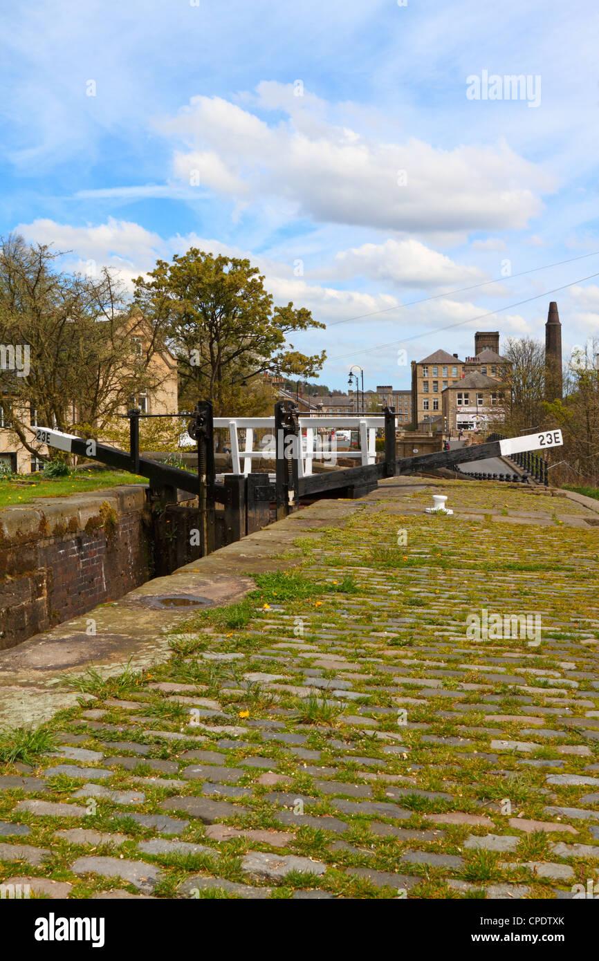 Lock gates on the Huddersfield Narrow Canal at Slaithwaite, Huddersfield, West Yorkshire, England, UK. - Stock Image