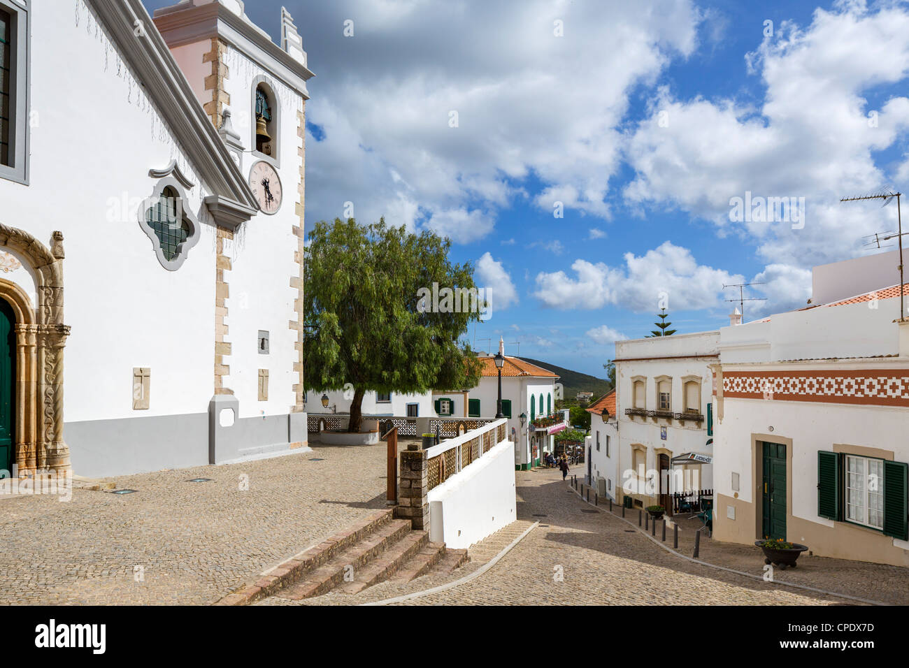 Centre of the inland village of Alte with the village church to the left, Algarve, Portugal - Stock Image