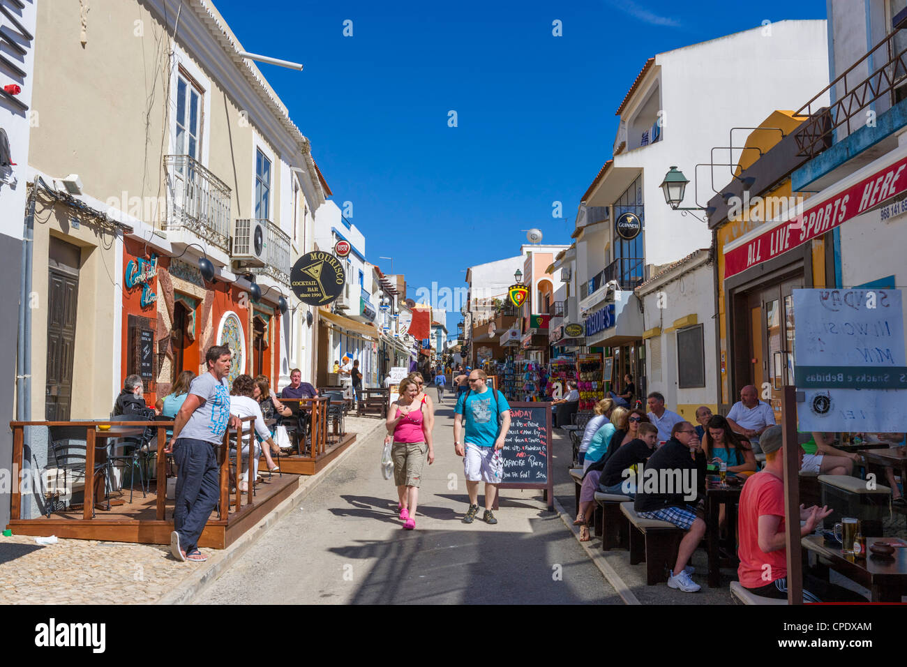 Shops and bars in the centre of the resort of Alvor, near Portimao, Algarve, Portugal - Stock Image
