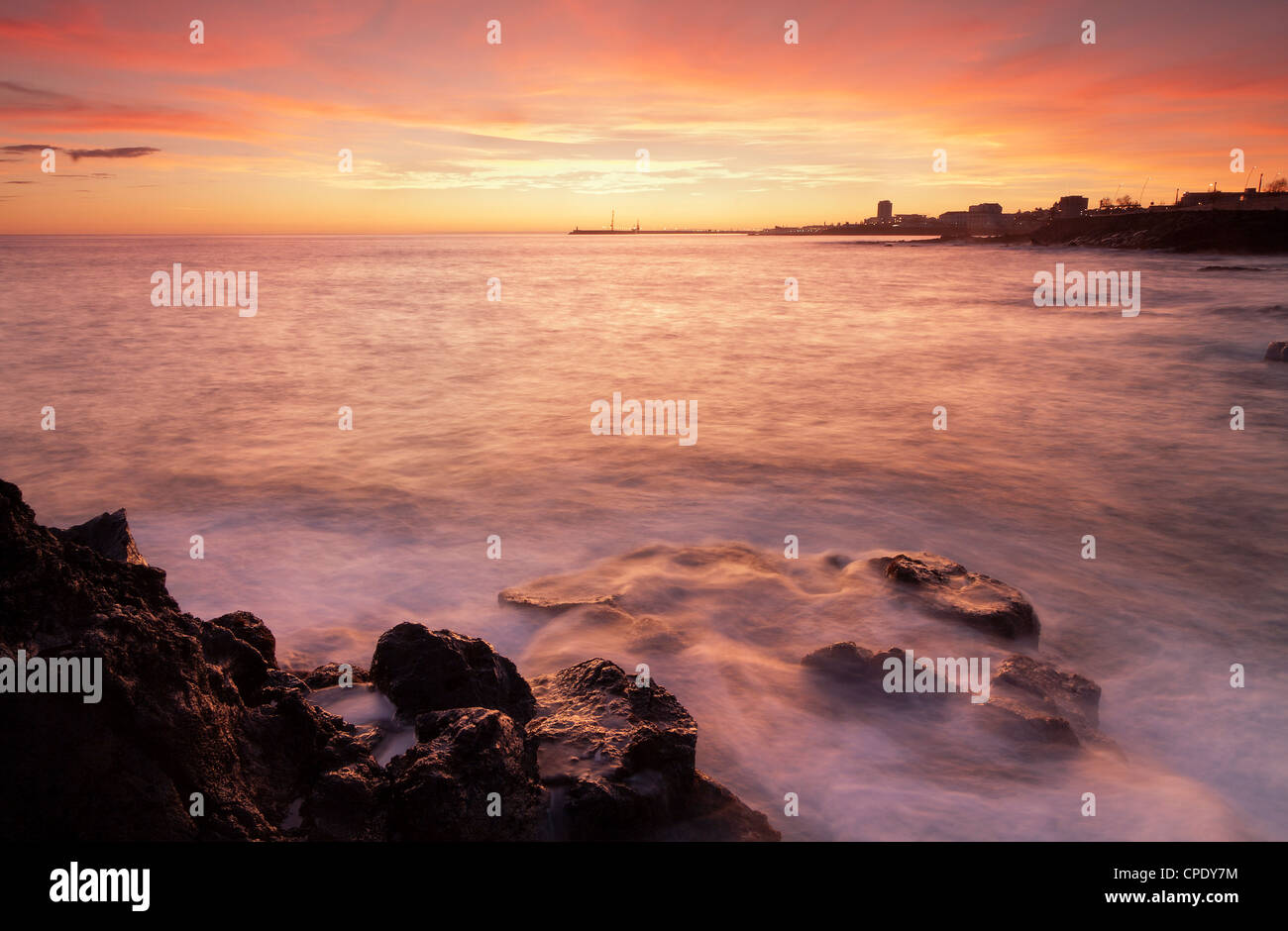 Landscape / waterscape during sunset on Ponta Delgada city in the Azores. - Stock Image