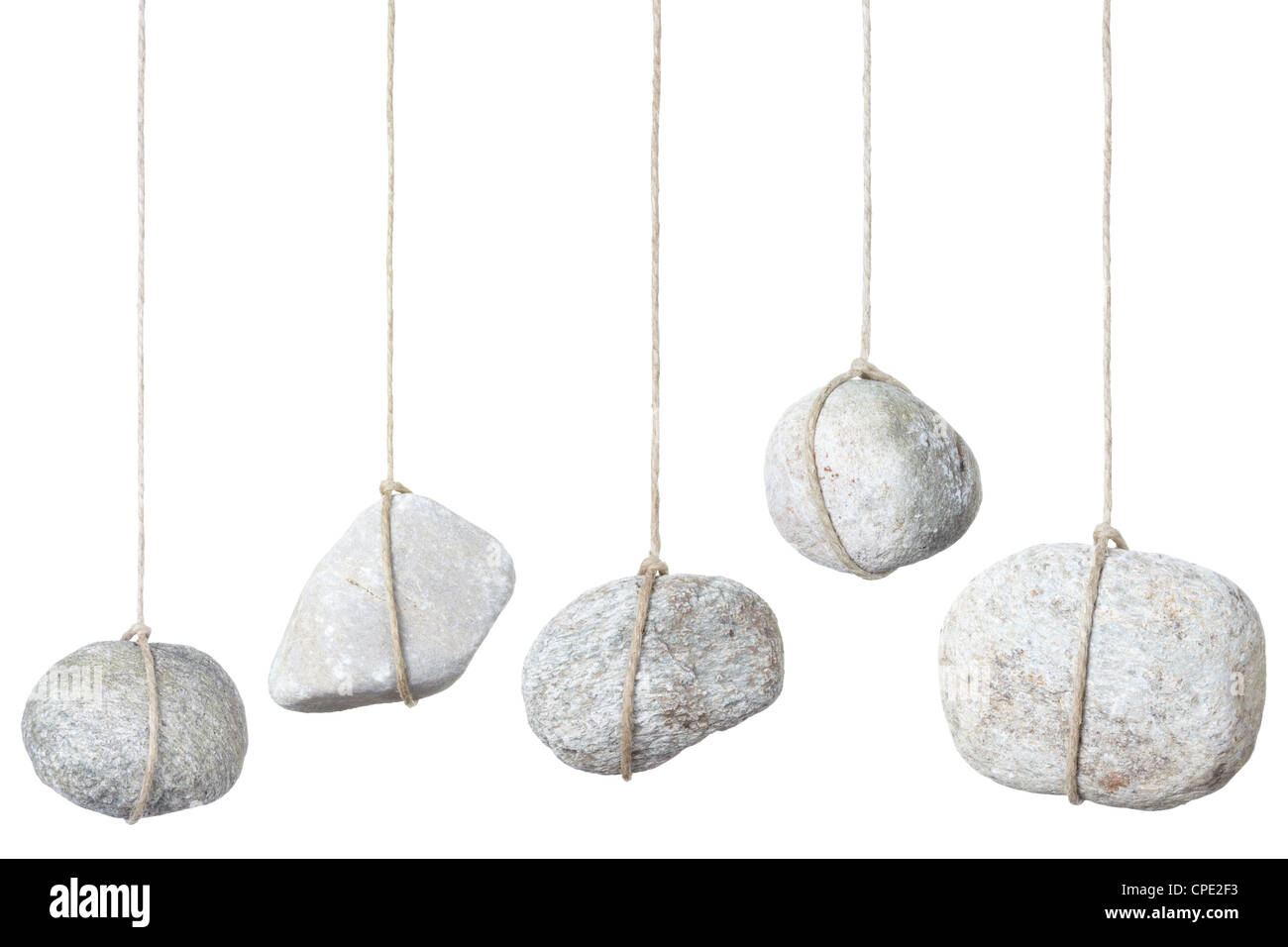 Stone hanging on a string - Stock Image