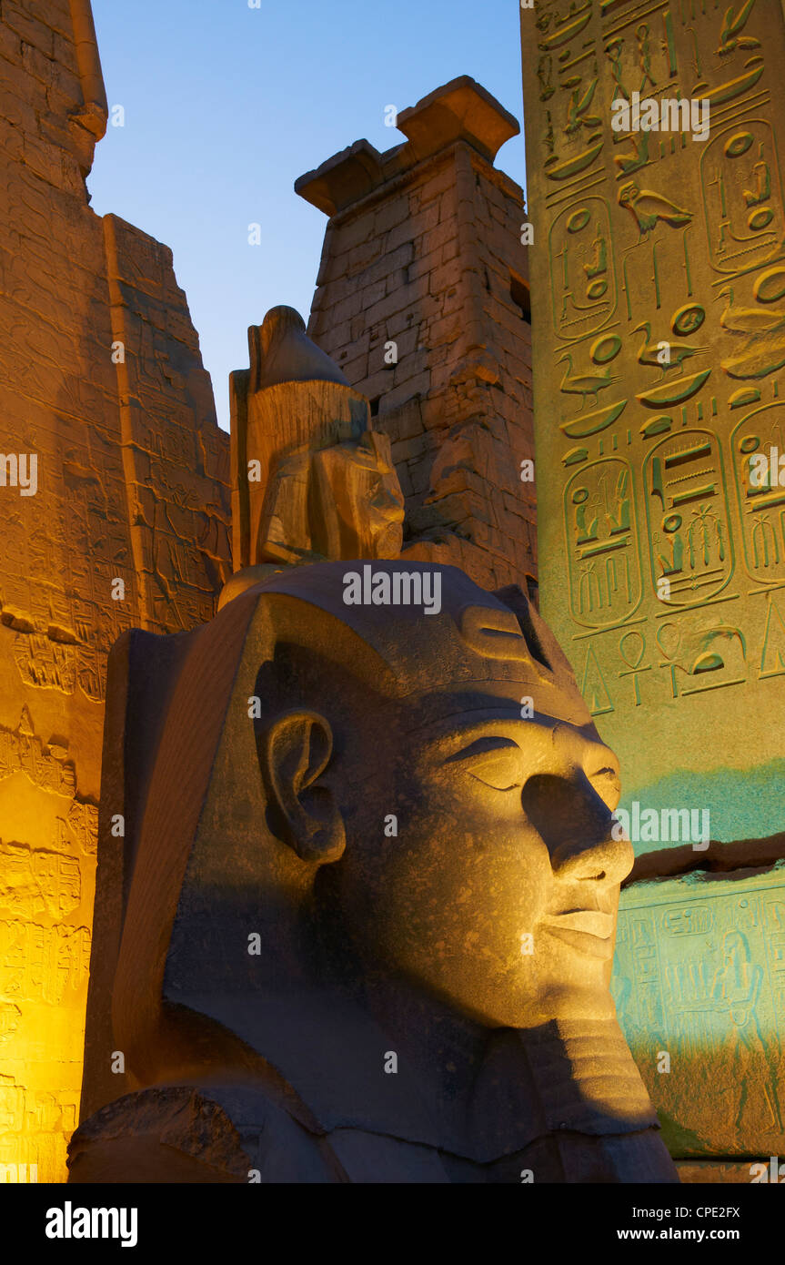 Statue of the pharaoh Ramesses II and Obelisk, Temple of Luxor, Thebes, UNESCO World Heritage Site, Egypt, North - Stock Image