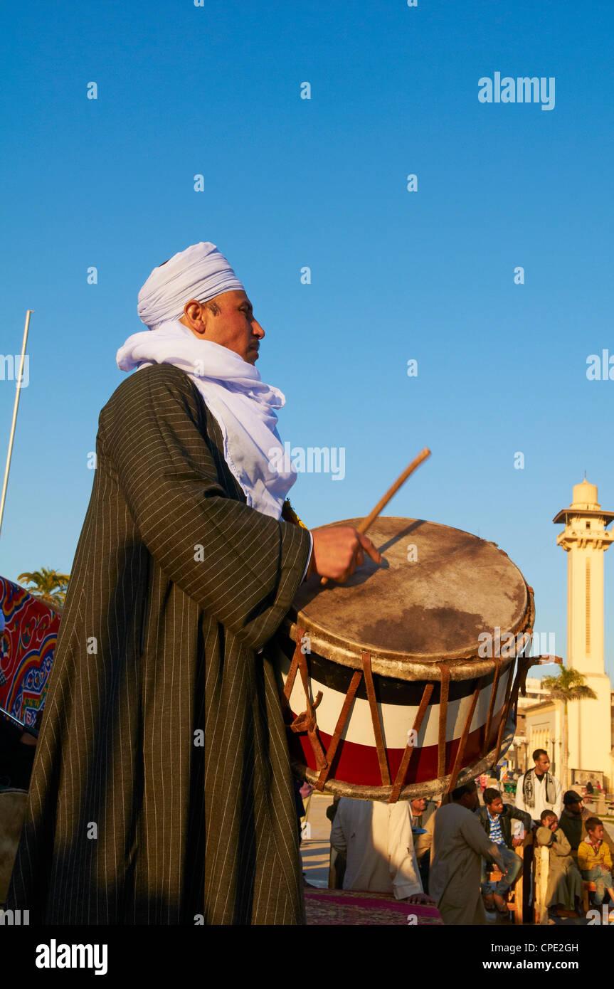 Drummer at Tahtib demonstration, Mosque of Abu el-Haggag, Luxor, Egypt - Stock Image