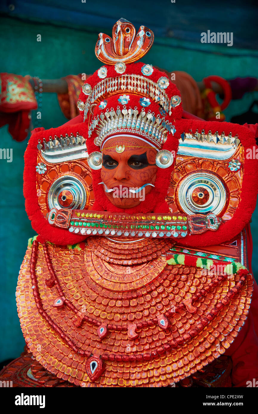 Man in costume representing a god at the Teyyam ceremony, near Kannur, Kerala, India, Asia - Stock Image