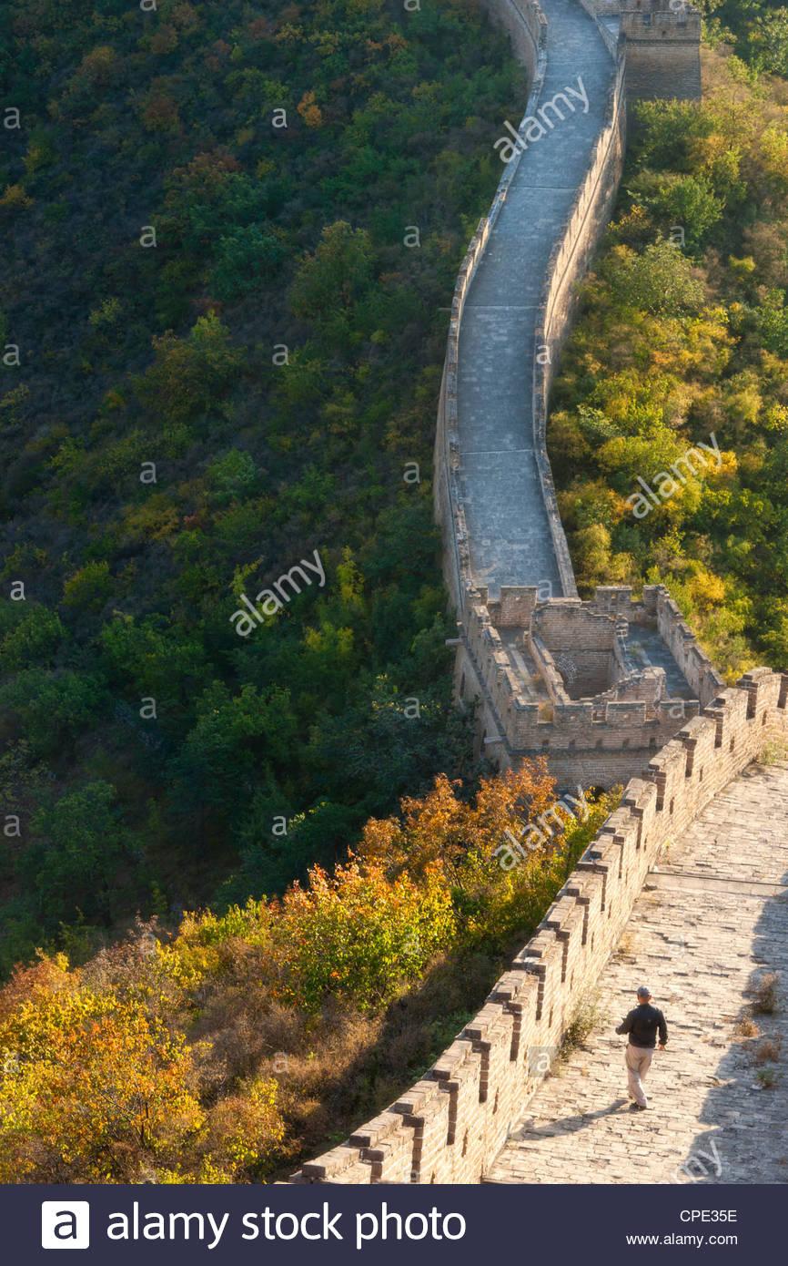 Hiker on Wild Wall, Great Wall of China, Huanghuacheng (Yellow Flower Wall) in autumn, Jiuduhe, Huairou, China, - Stock Image