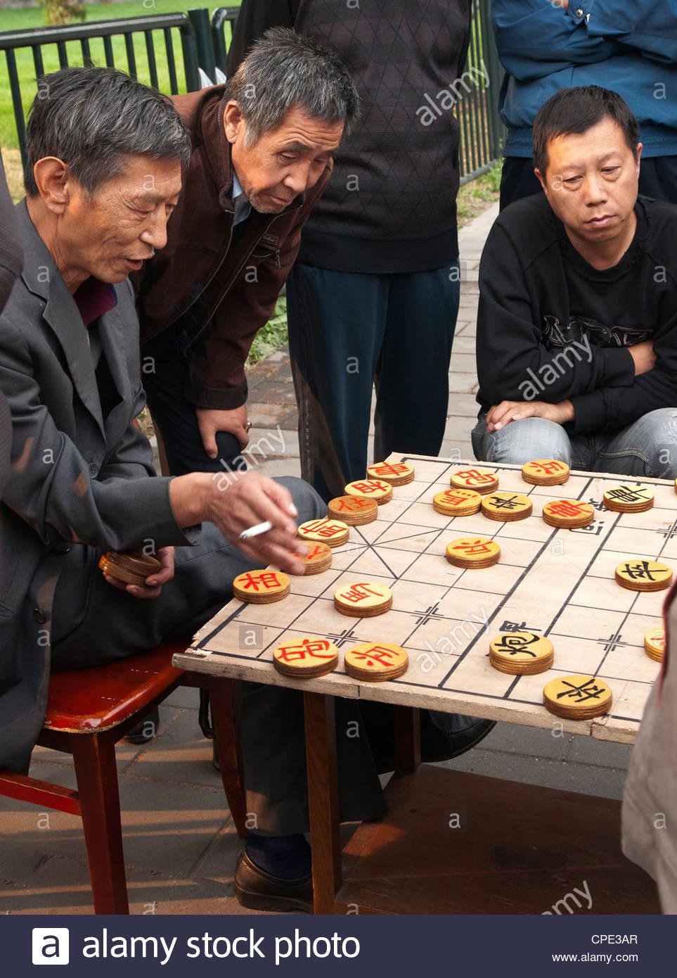 Men playing Chinese chess, Beijing, China, Asia Stock Photo