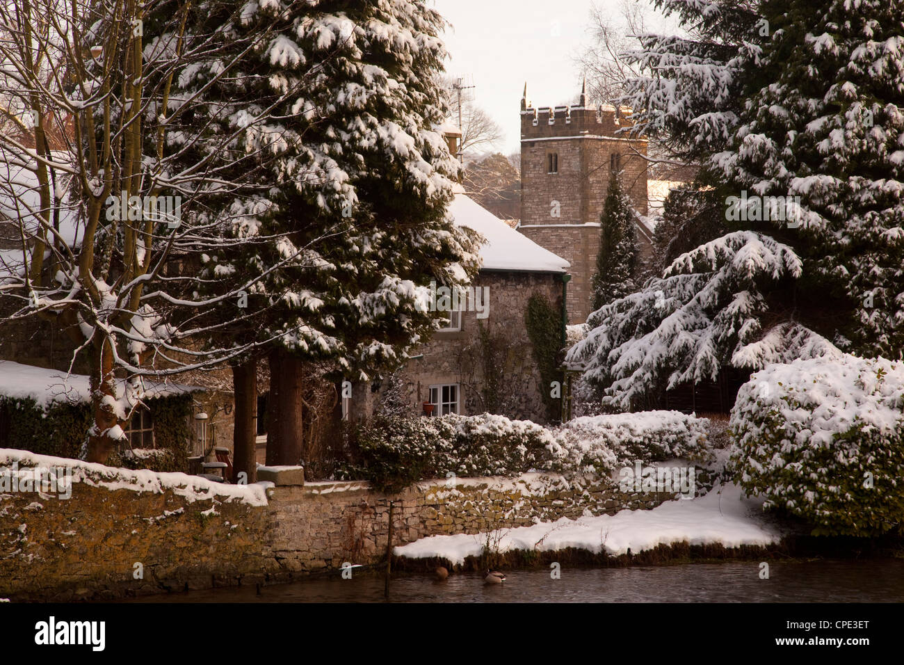 Cottage and church, Ashford in the Water, Derbyshire, England, United Kingdom, Europe - Stock Image