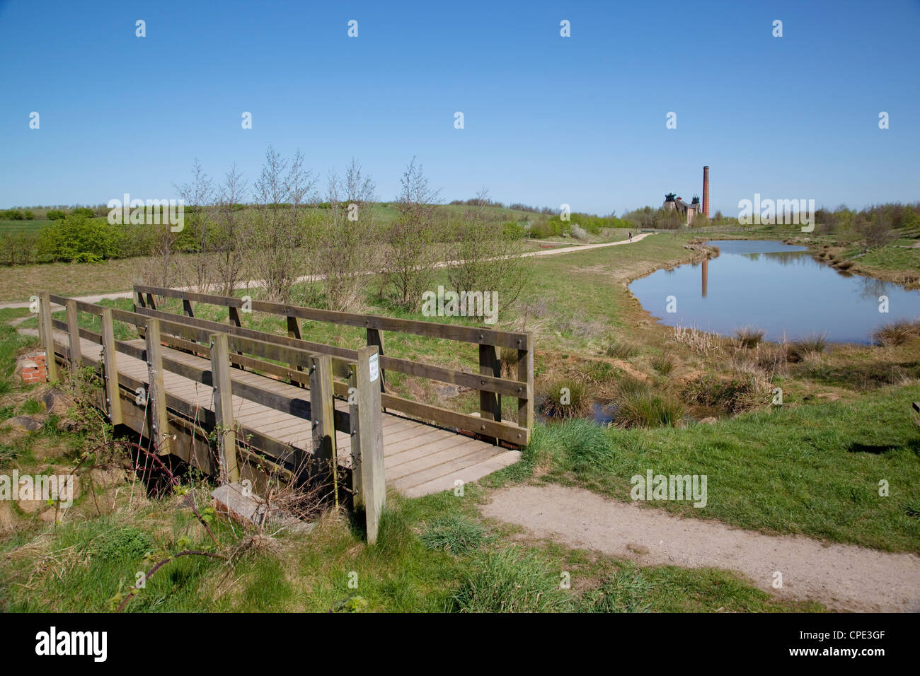 Pleasley Colliery reflecting in pond, Derbyshire, England, United Kingdom, Europe - Stock Image