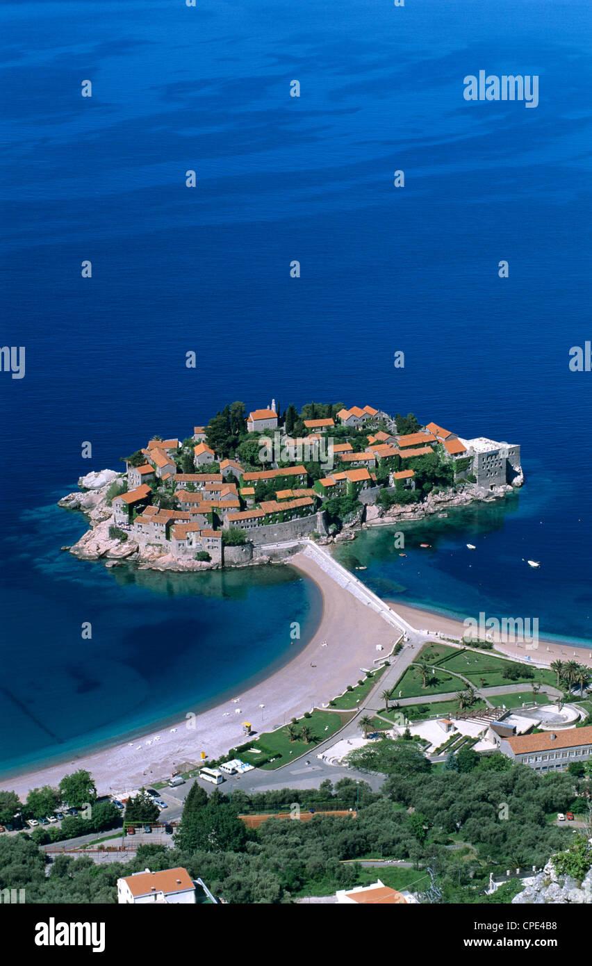 Aerial view over island and sandbar, Sveti Stefan, The Budva Riviera, Montenegro, Europe - Stock Image
