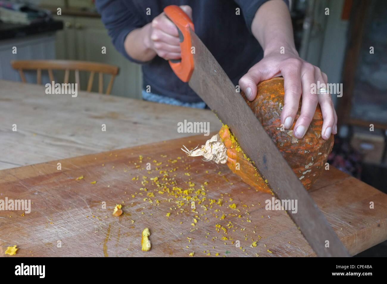 A Pumpkin skin so tough it takes a saw to get through it - Stock Image