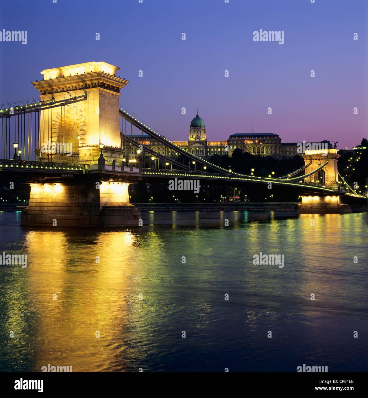 Royal Palace (Budavari Palota) (Buda Castle) and Chain Bridge at dusk, Buda, Budapest, Hungary, Europe Stock Photo