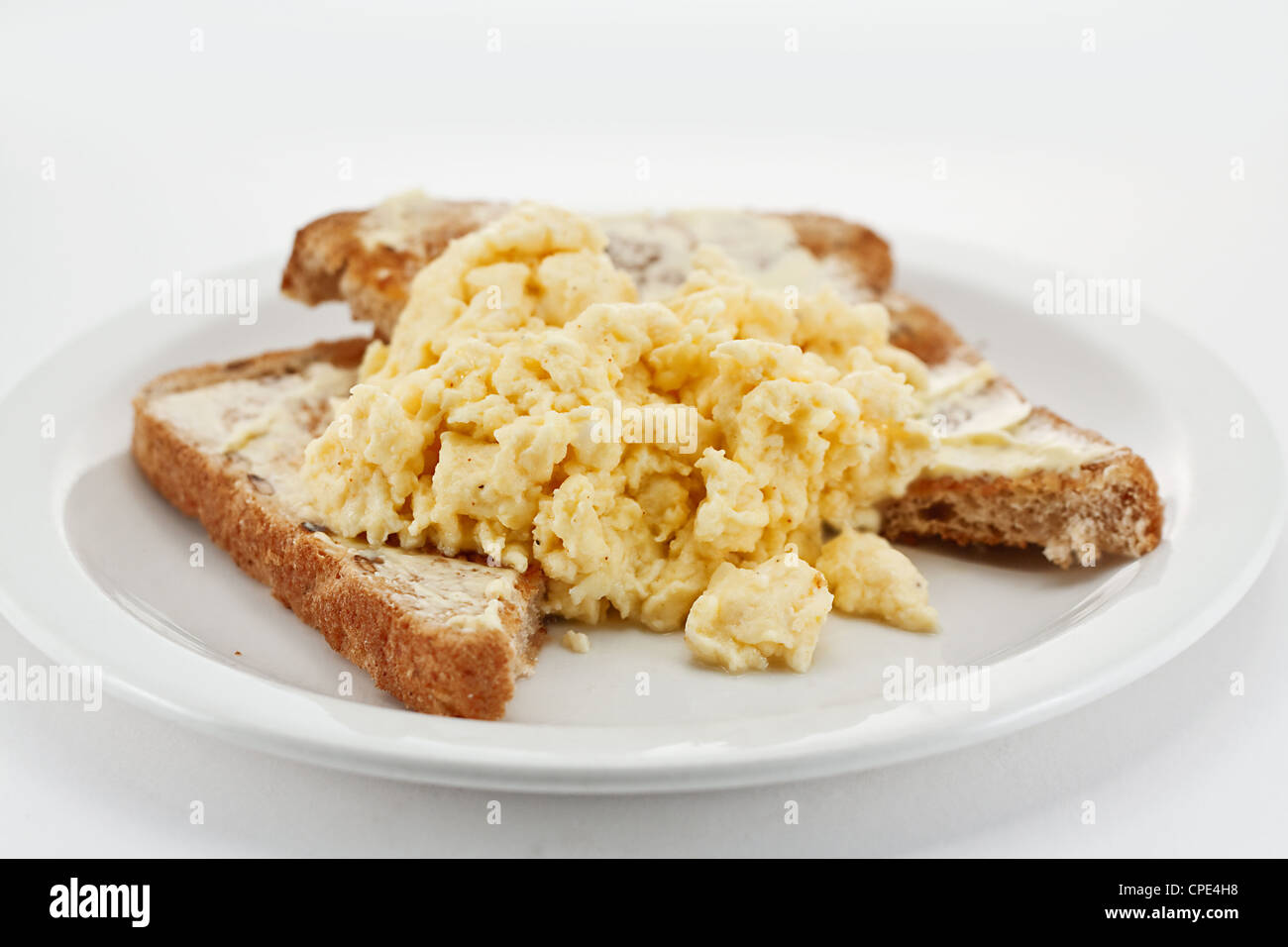 Scrambled eggs on toast close up - Stock Image