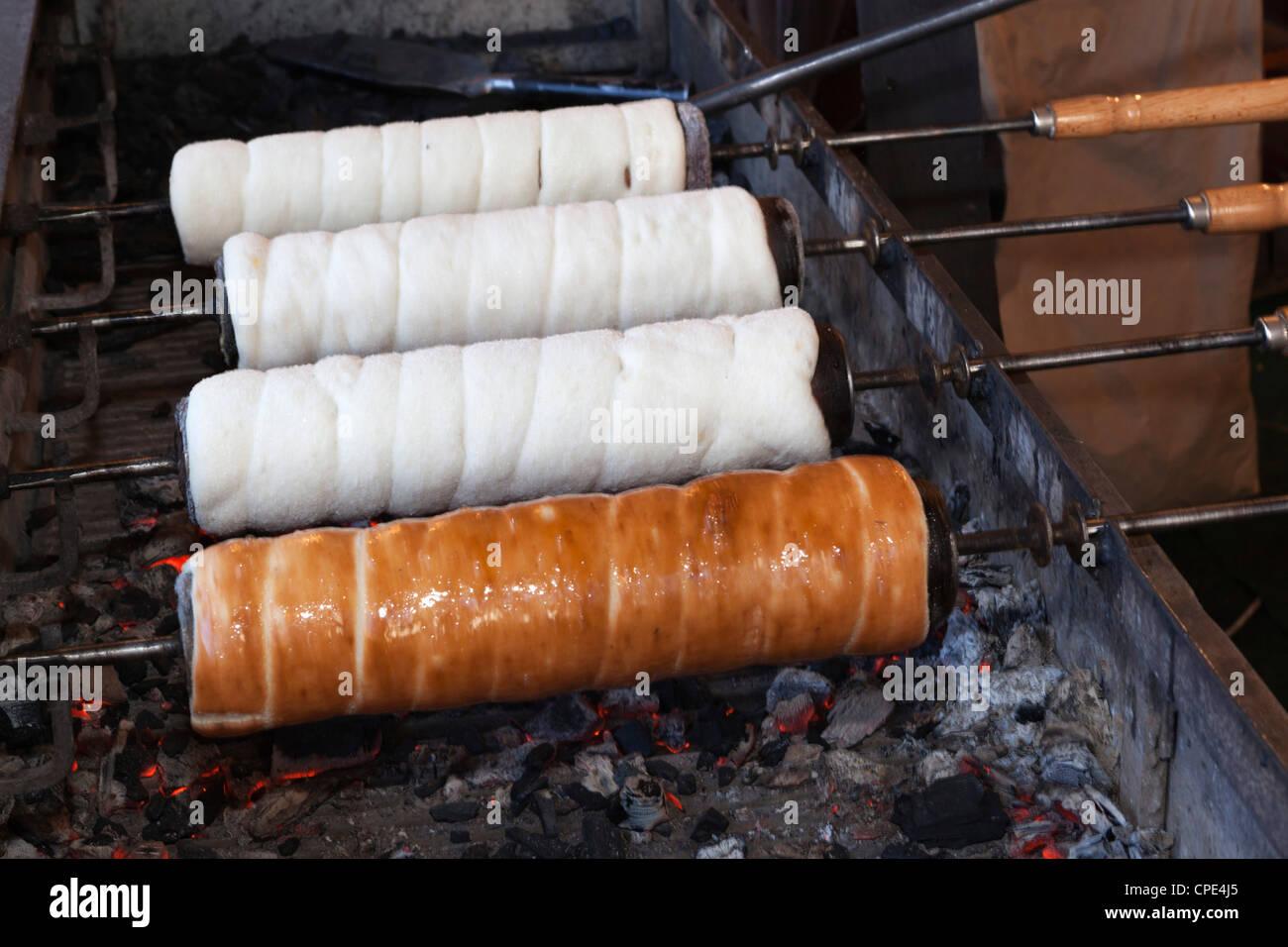Kurtoskalacs (chimney cake) (stove cake) cooking over coals, Budapest, Hungary, Europe - Stock Image