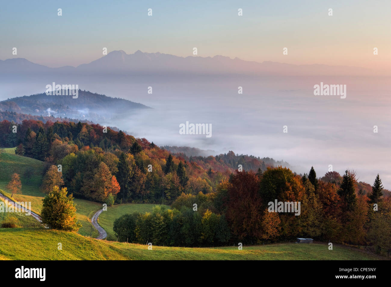 Mist over the Ljubljana Basin at sunrise in autumn, Central Slovenia, Slovenia, Europe - Stock Image