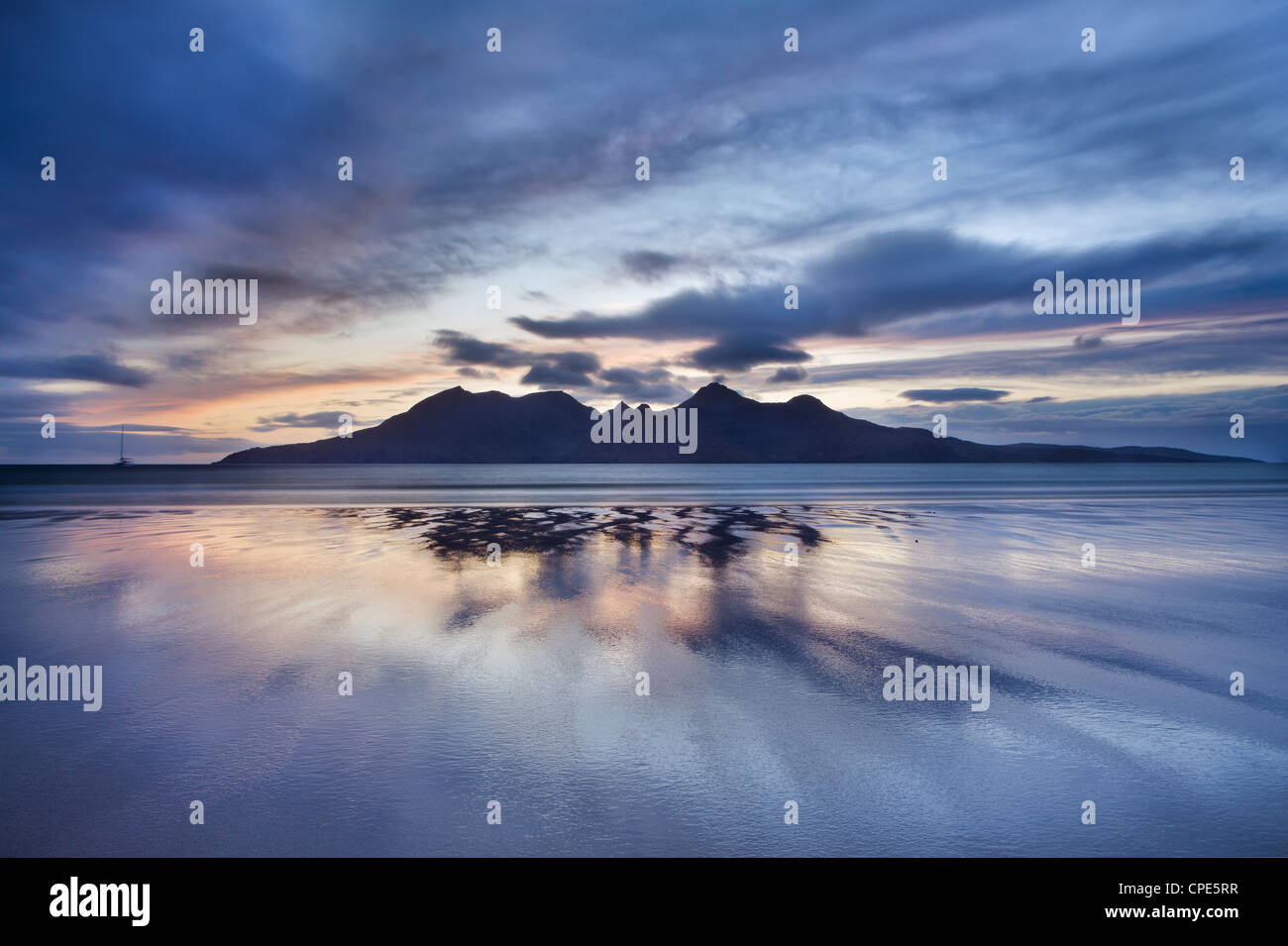 Dusk, looking to towards Rum from the Bay of Laig on Eigg, Inner Hebrides, Scotland, United Kingdom, Europe - Stock Image