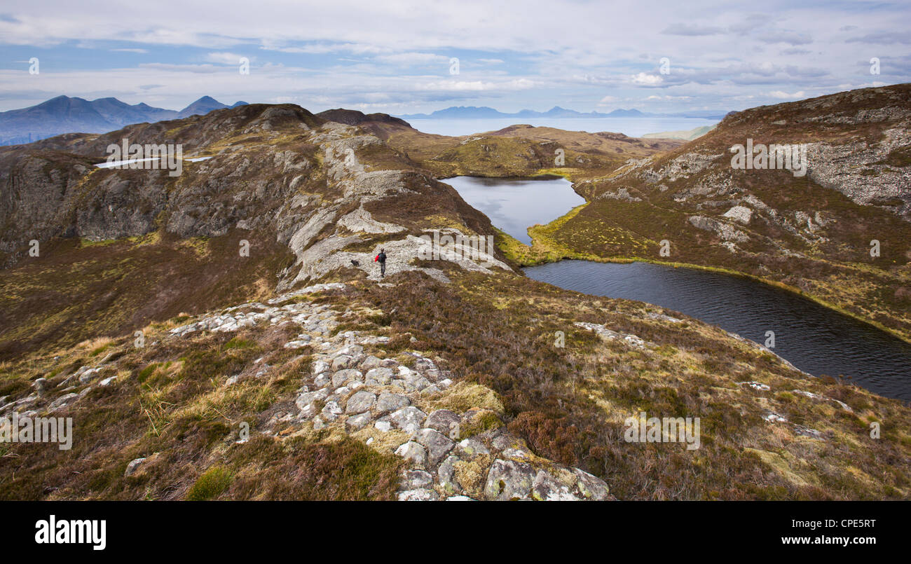Walking along the pitchstone ridges on Eigg, Inner Hebrides, Scotland, United Kingdom, Europe - Stock Image