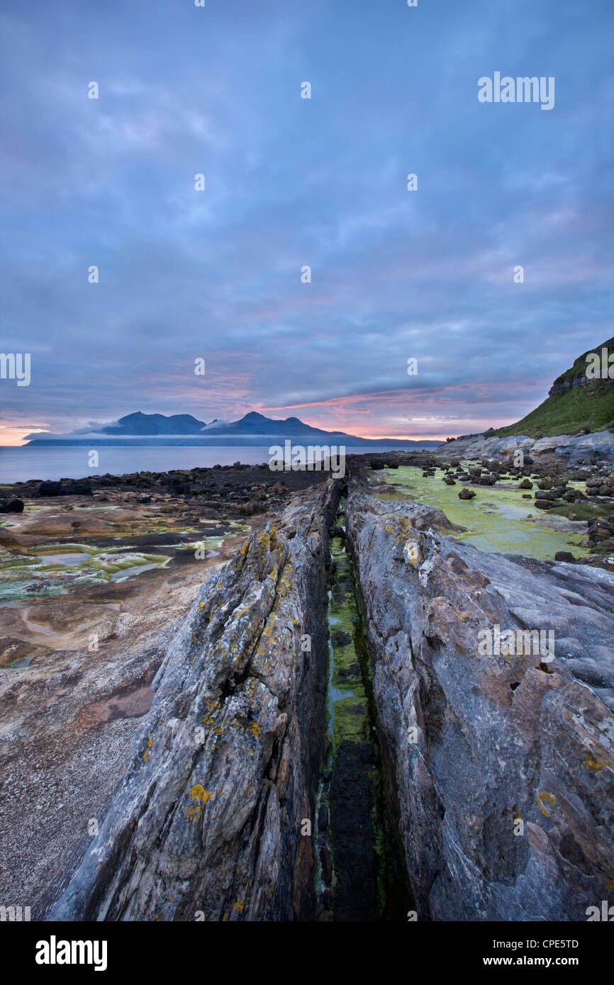 Dusk on the Isle of Eigg with Rum in the distance, Inner Hebrides, Scotland, United Kingdom, Europe - Stock Image