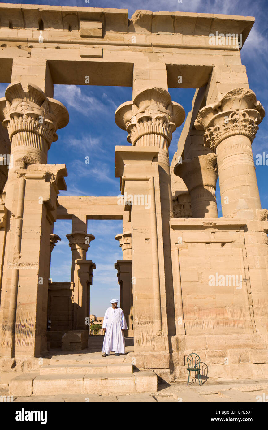 Man in white jellabiya in front of the Kiosk of Trajan at the Philae Temples, UNESCO World Heritage Site, Nubia, - Stock Image