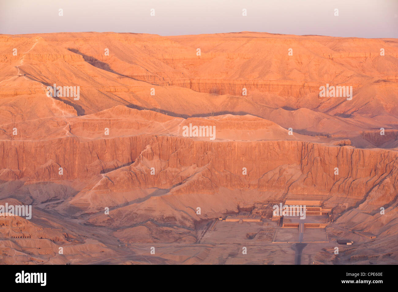 Aerial view from hot air balloon of Hatshepsut's Mortuary Temple at sunrise, Deir el-Bahri, Thebes, Egypt, Africa - Stock Image