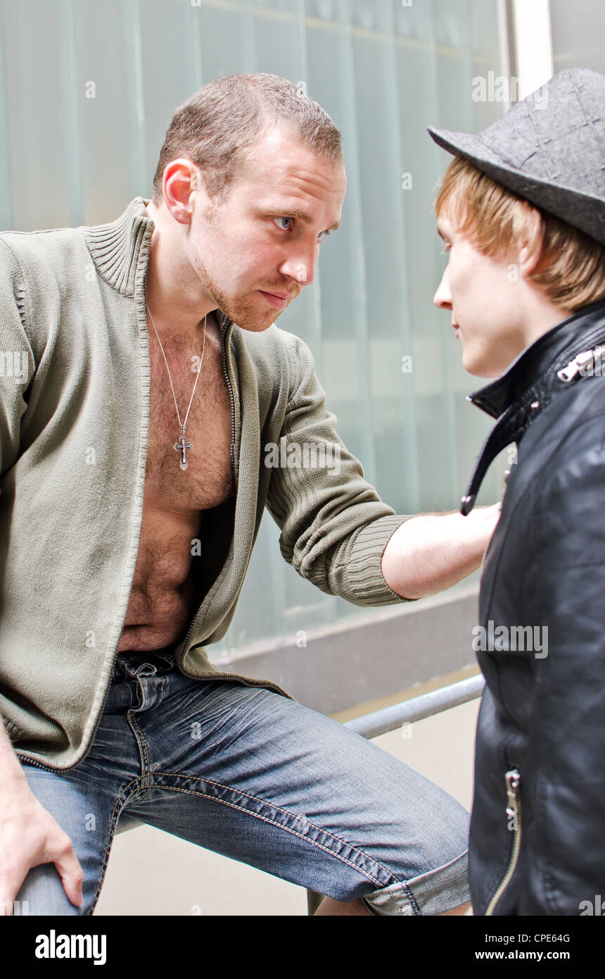 Tough guys. Mafia boss communicates with his assistant - Stock Image