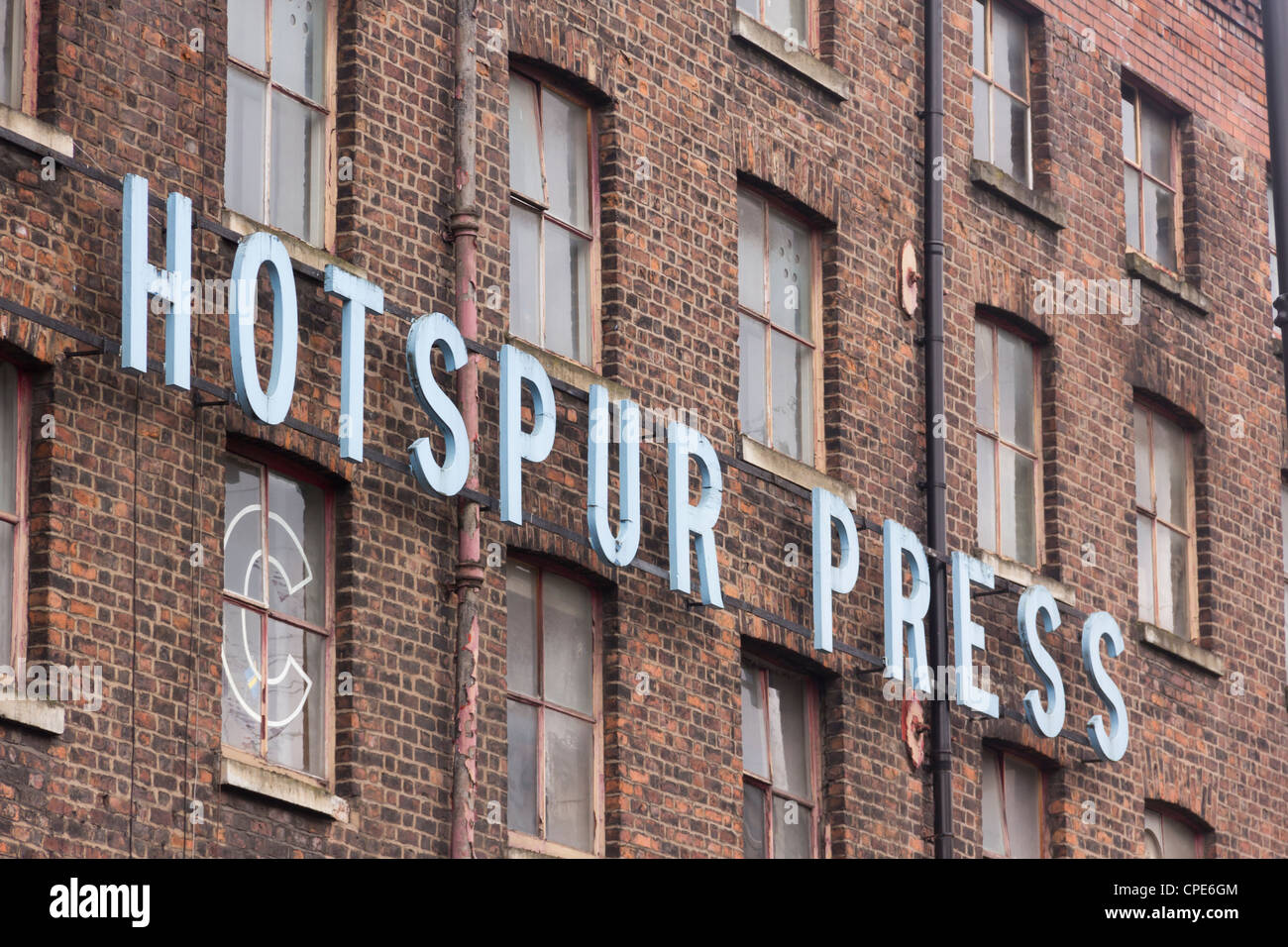 A section of the Hotspur Press Building on Cambridge Street in Manchester, a place of new developments in creative - Stock Image