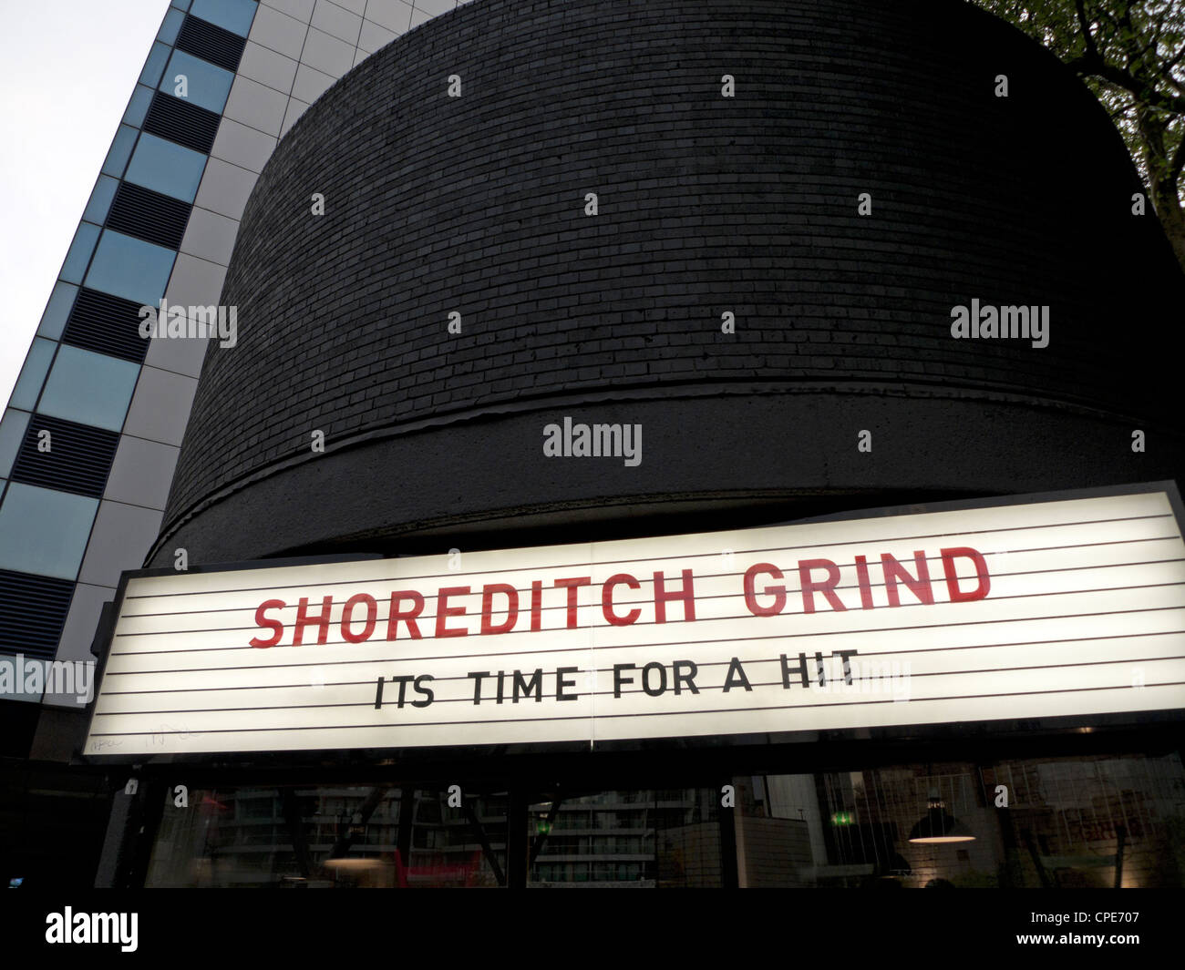 Independent Espresso coffee bar shop Shoreditch Grind sign at Old Street roundabout in London England UK  KATHY - Stock Image
