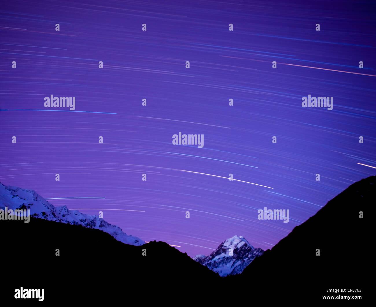 Long exposure of night sky over Aoraki Mount Cook National Park, UNESCO World Heritage Site, South Island, New Zealand, - Stock Image
