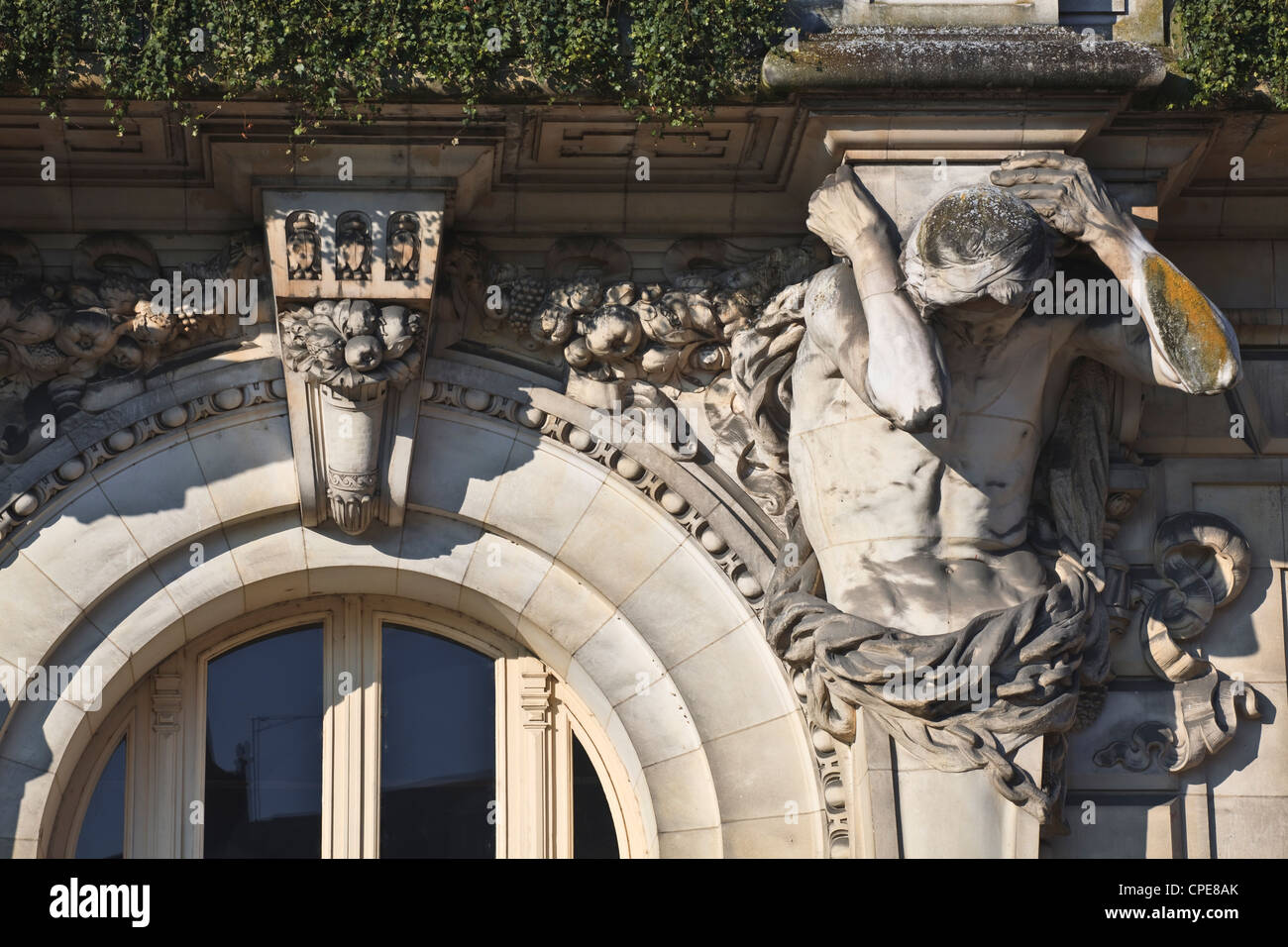 One of the four Atlantes on the hotel de ville (town hall), Tours, France, Europe - Stock Image
