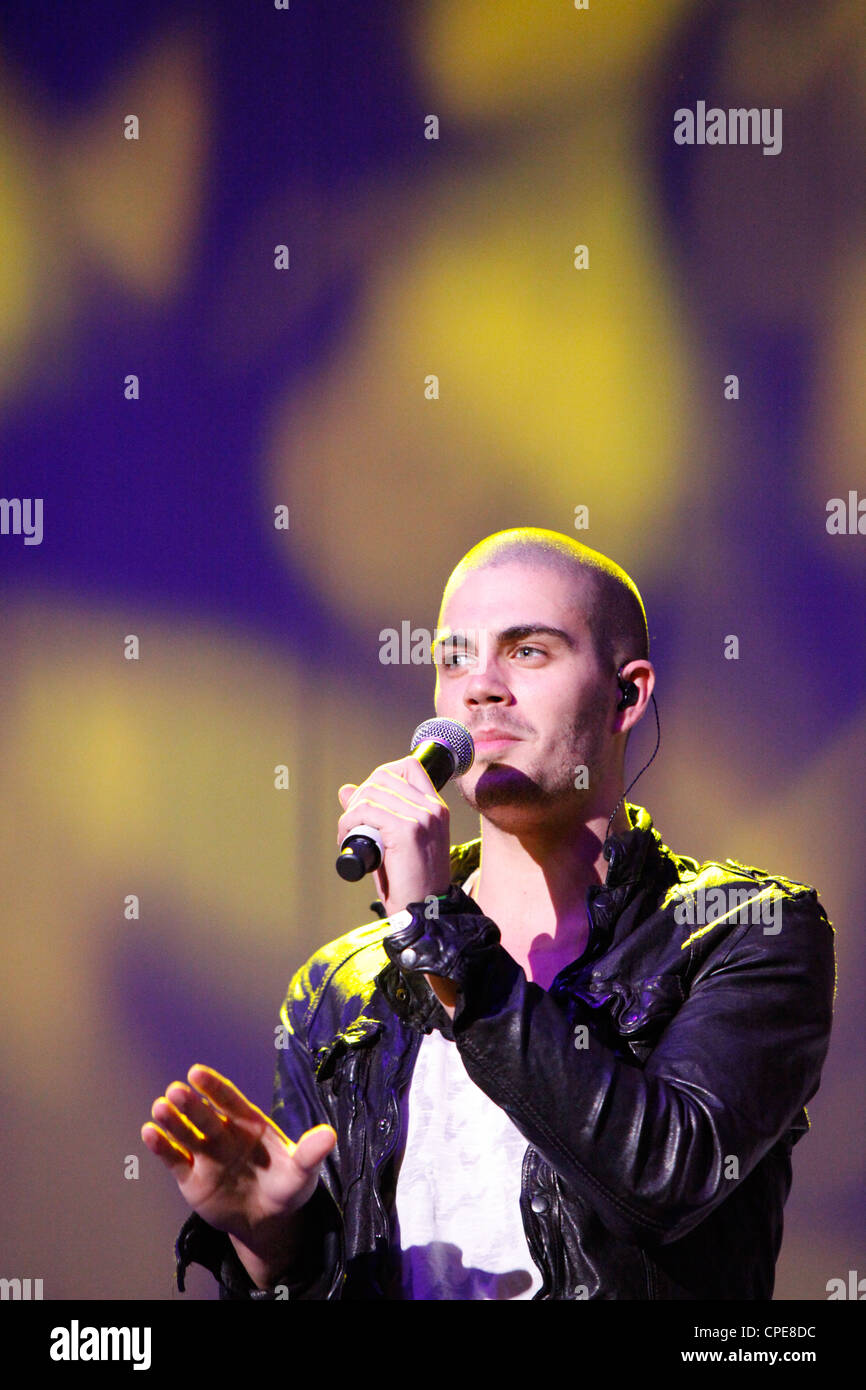Max George of the boyband The Wanted performs on stage at Birmingham's LG Arena at The BRMB Live concert in - Stock Image