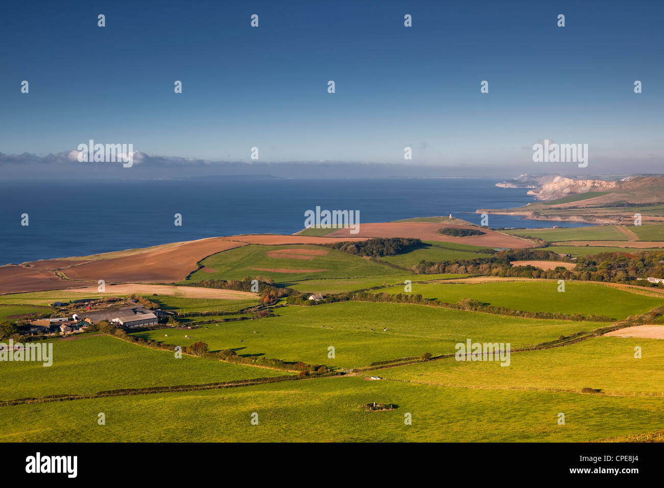 Looking across the Dorset coastline to Kimmeridge Bay and Clavell Tower, Jurassic Coast, Dorset, England, United - Stock Image
