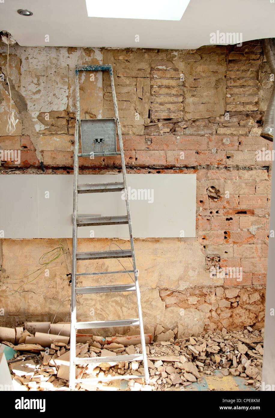 demolition debris in kitchen interior construction and ladder - Stock Image