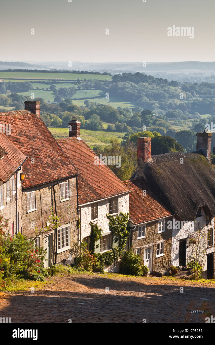 The famous cobbled street of Gold Hill in Shaftesbury, Dorset, England, United Kingdom, Europe - Stock Image