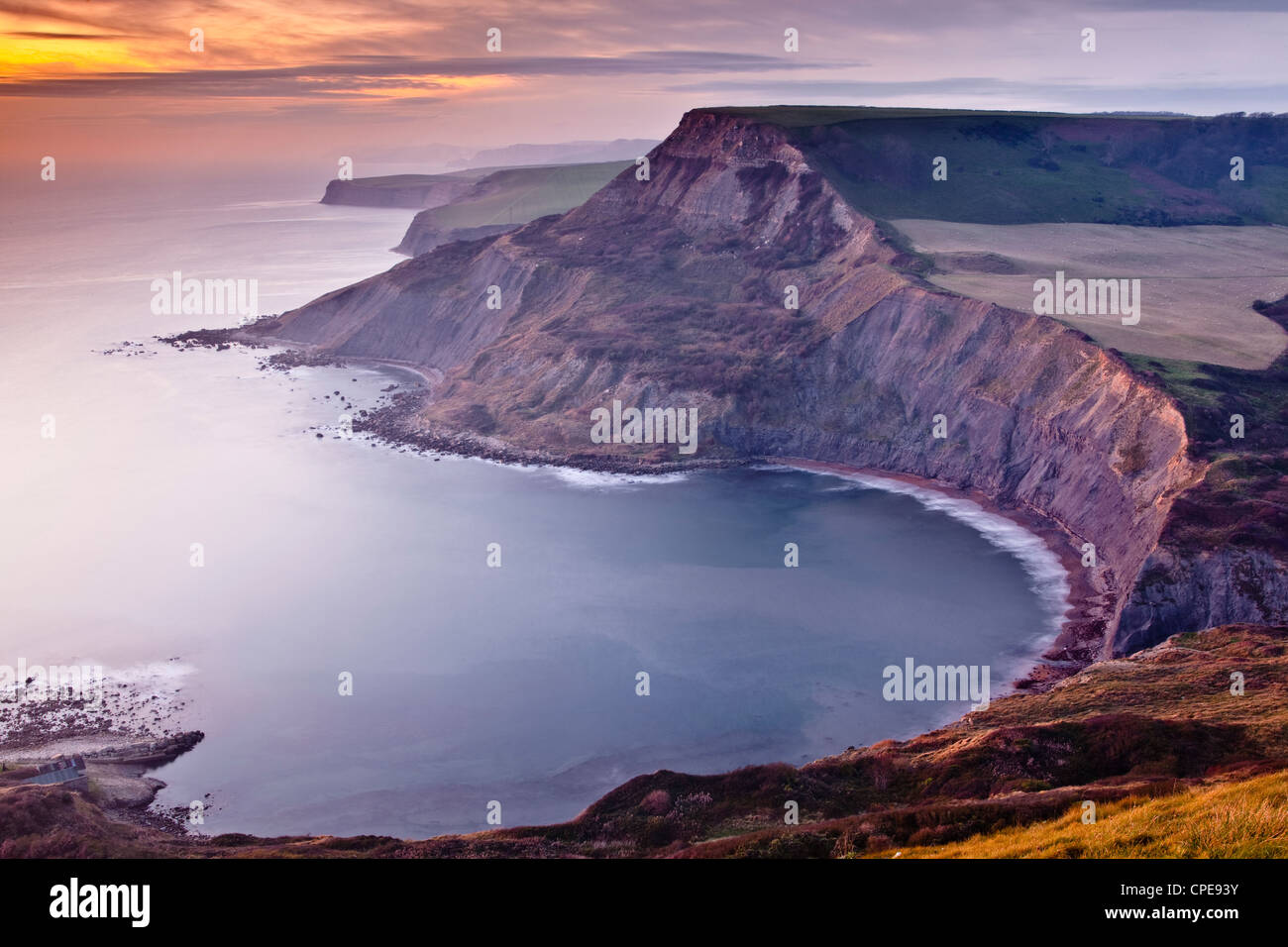 A beautiful sunset over Chapman's Pool on Dorset's Jurassic Coast, Dorset, England, United Kingdom, Europe - Stock Image