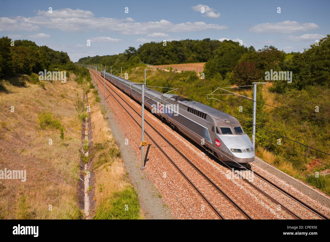 A TGV train speeds through the French countryside near to Tours, Indre-et-Loire, Centre, France, Europe - Stock Image