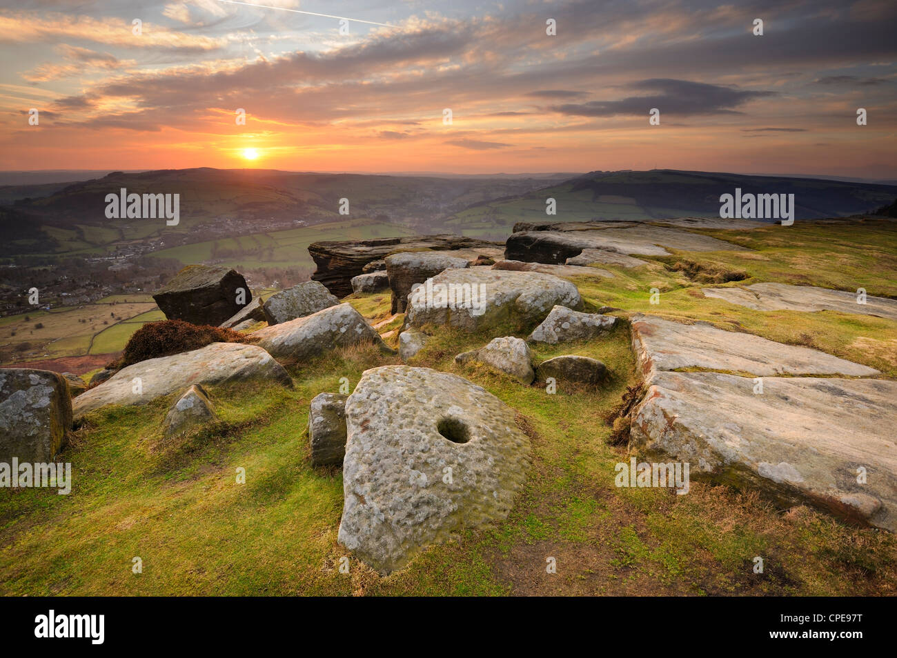 Sunset over millstones, Froggatt and Curbar Edge, Peak District National Park, Derbyshire, England, United Kingdom, - Stock Image