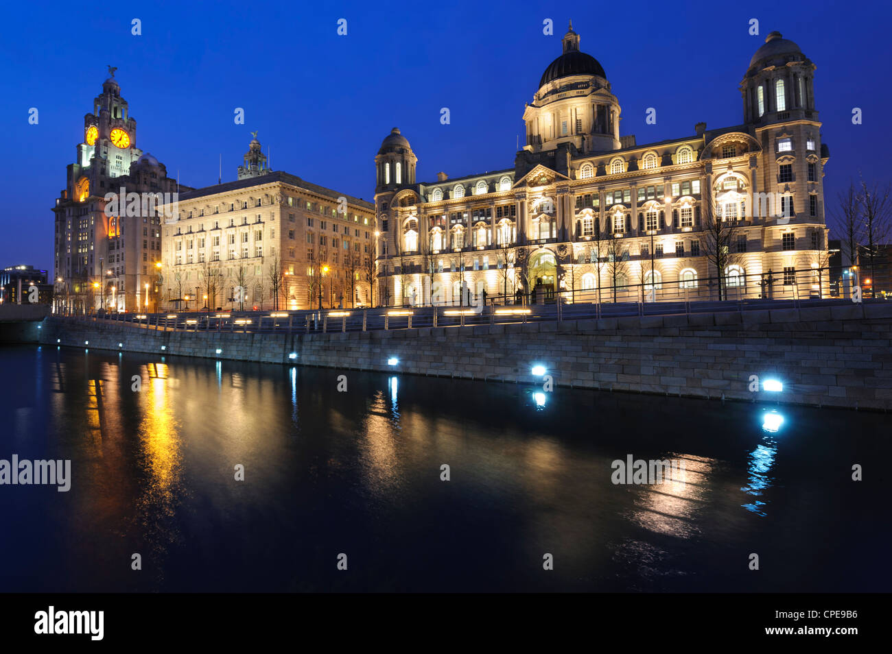 The Three Graces at dusk, Cunard Building, Port of Liverpool Building, Liverpool, Merseyside, England, UK - Stock Image