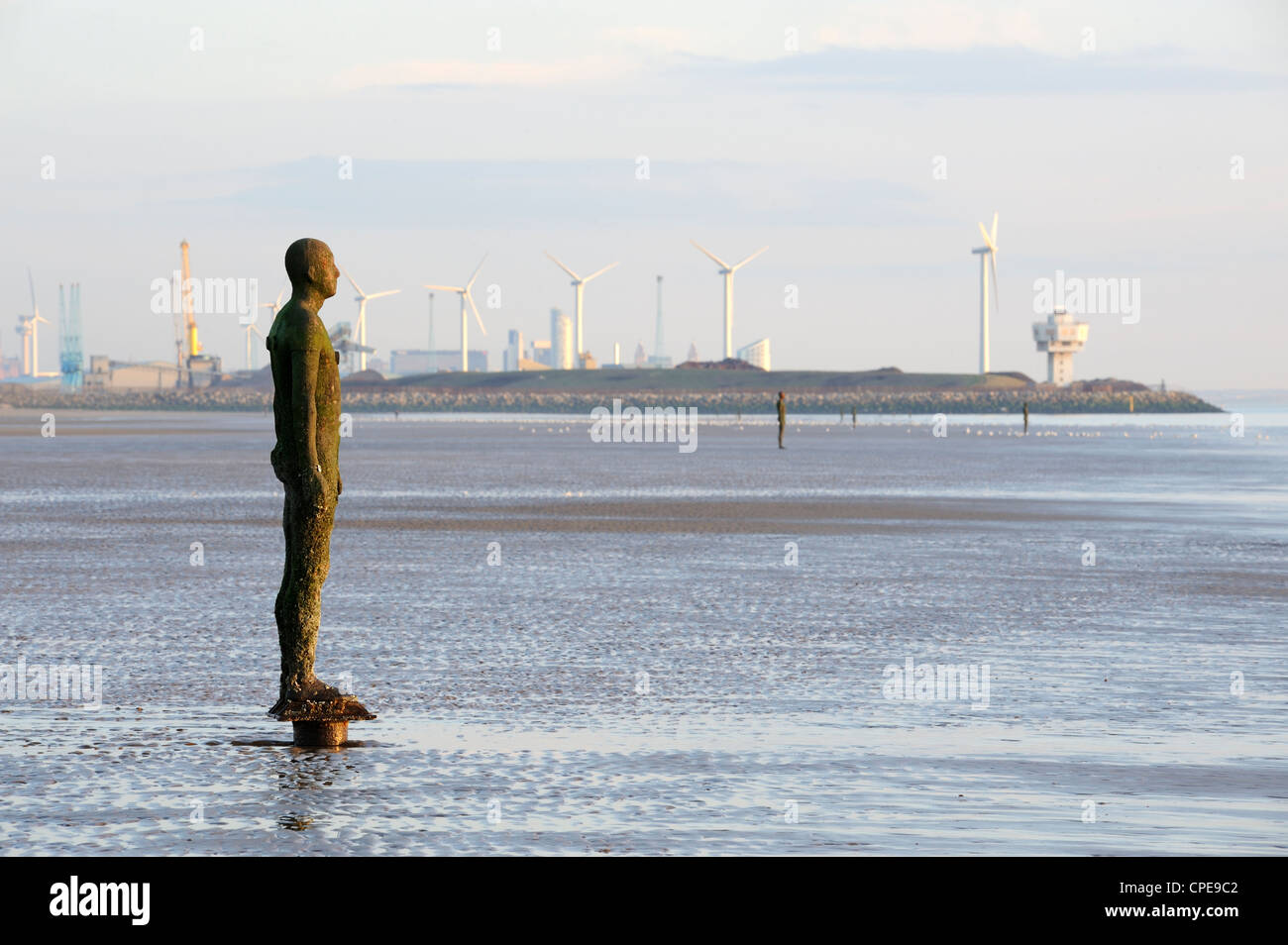 Antony Gormley sculpture, Another Place, Crosby Beach, Merseyside, England, United Kingdom, Europe - Stock Image
