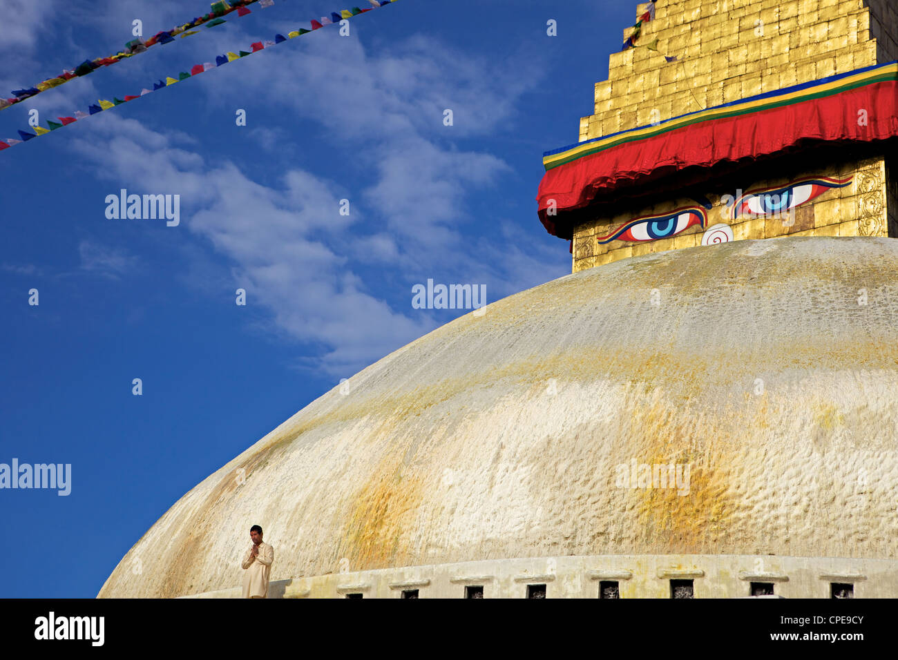 Man praying in front of the dome of Boudha (Bodhnath) (Boudhanath) stupa, Kathmandu, UNESCO World Heritage Site, Stock Photo