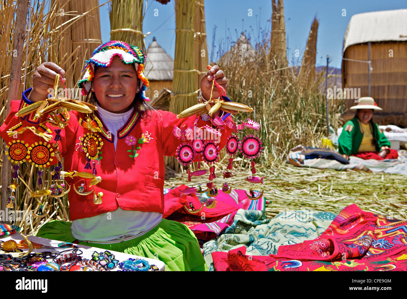 Portrait of a Uros Indian woman selling souvenirs, Islas Flotantes (Floating Islands), Lake Titicaca, Peru, South - Stock Image