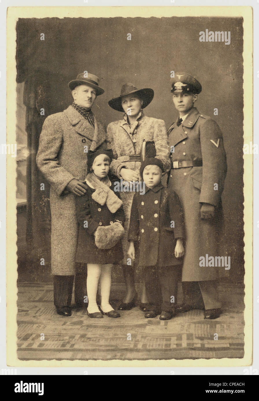 Postcard of family, probably German - the eldest son is in uniform, Luftwaffe, 1938, WWii) Germany Stock Photo