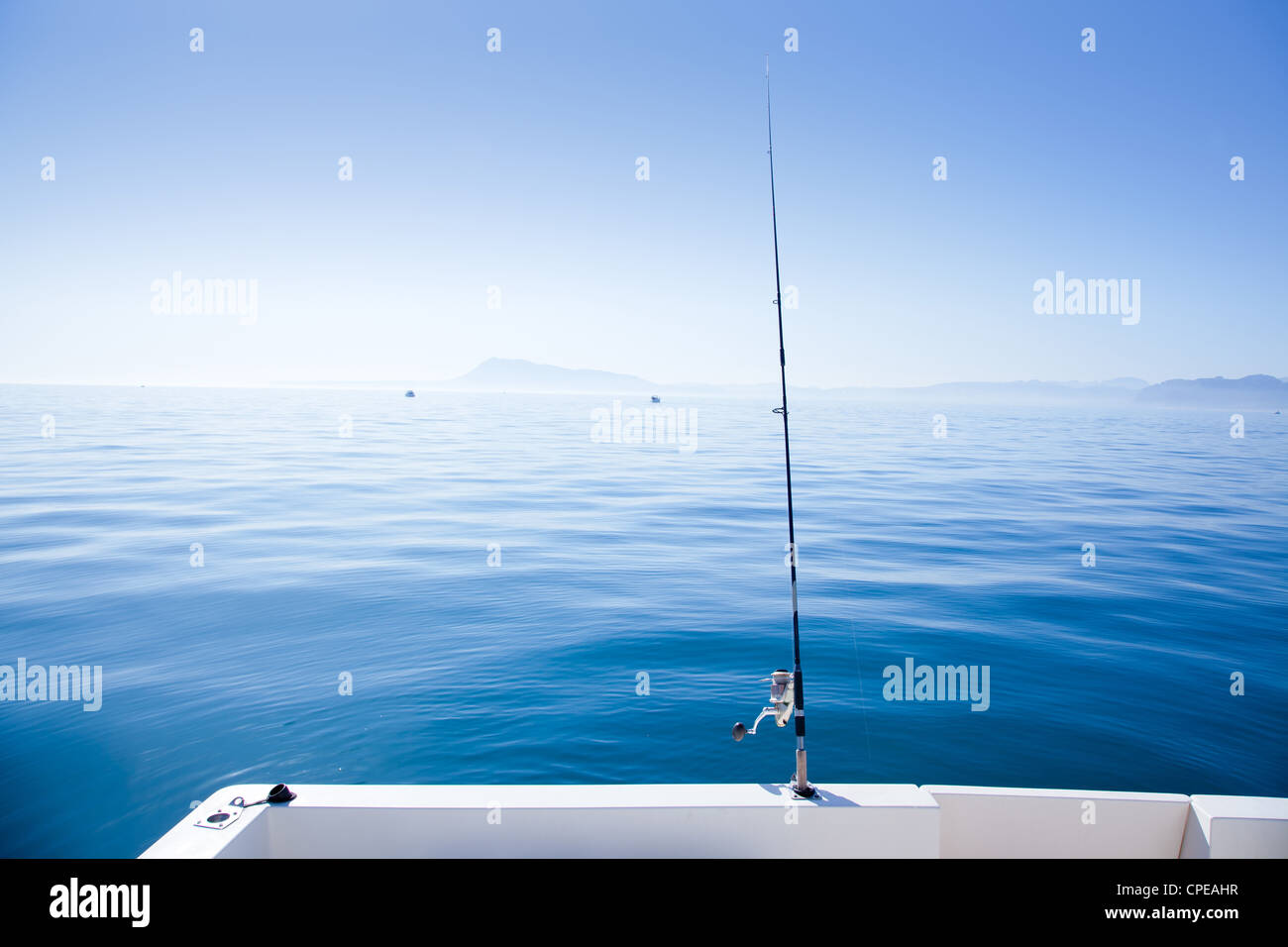 boat fishing rod in mediterranean blue sea in Spain - Stock Image