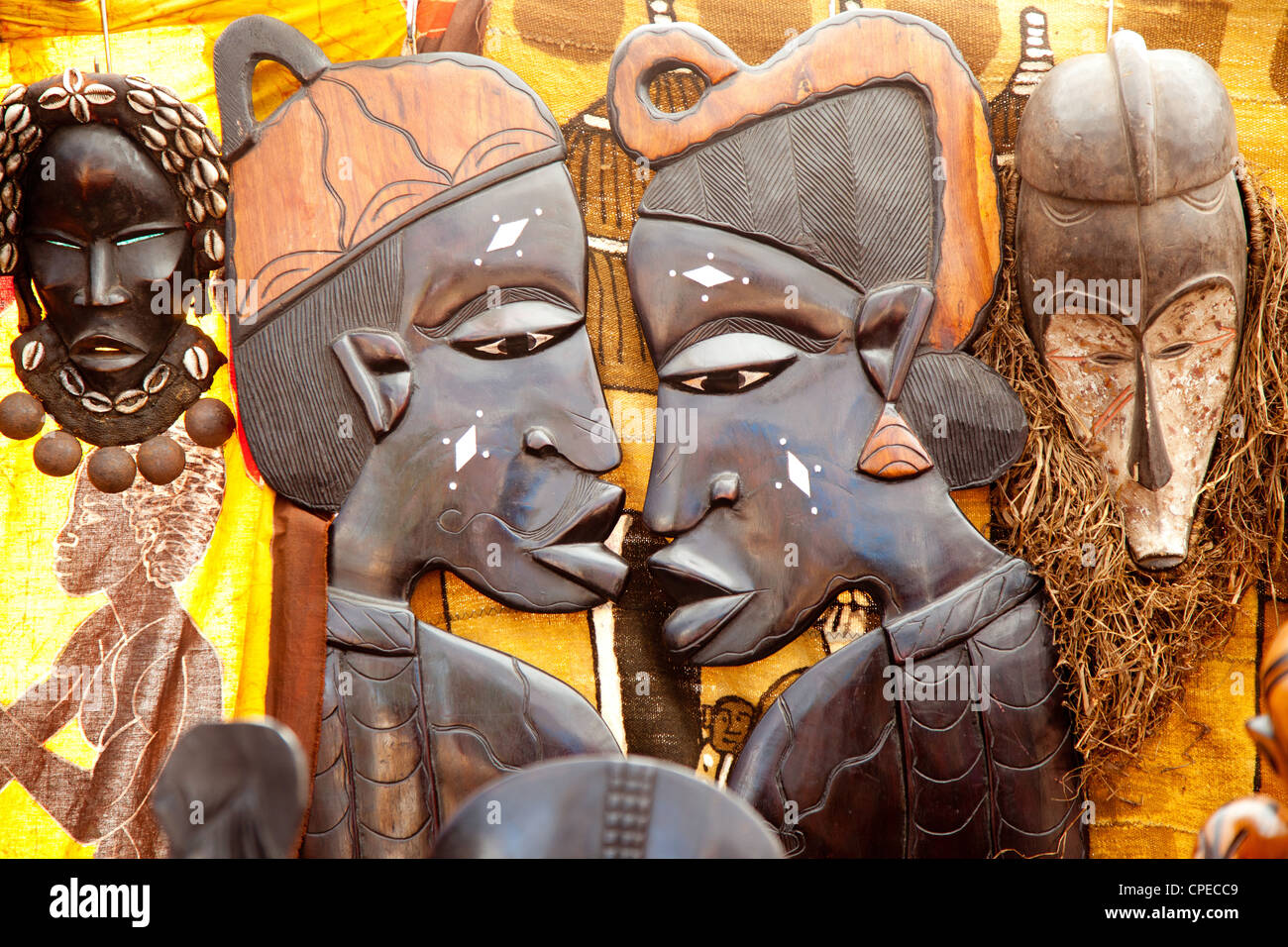 african handcraft dark wood carved profile faces - Stock Image