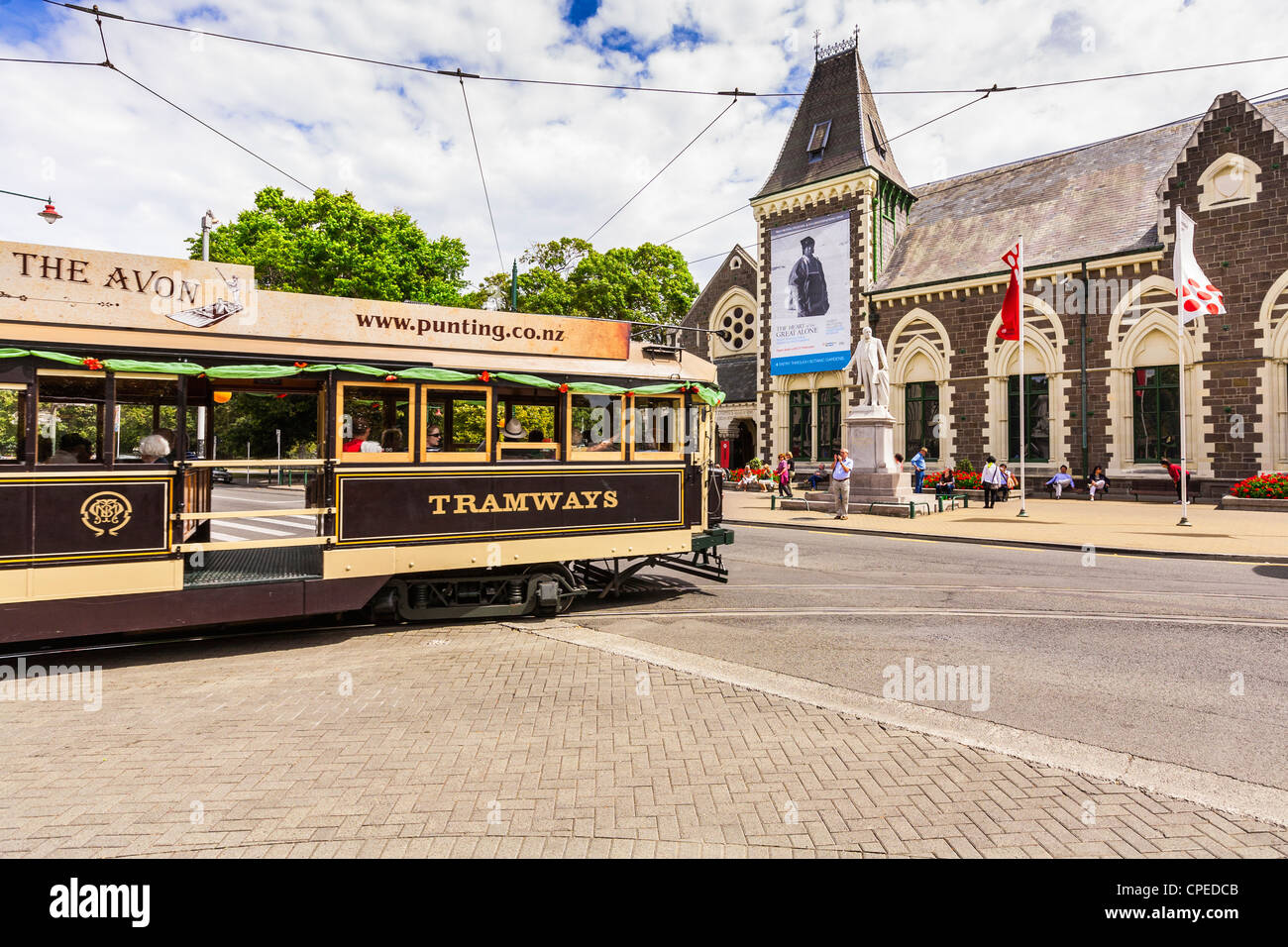 A restored tram turns from Worcester Boulevard into Rolleston Avenue, past the Canterbury Museum in Christchurch, - Stock Image