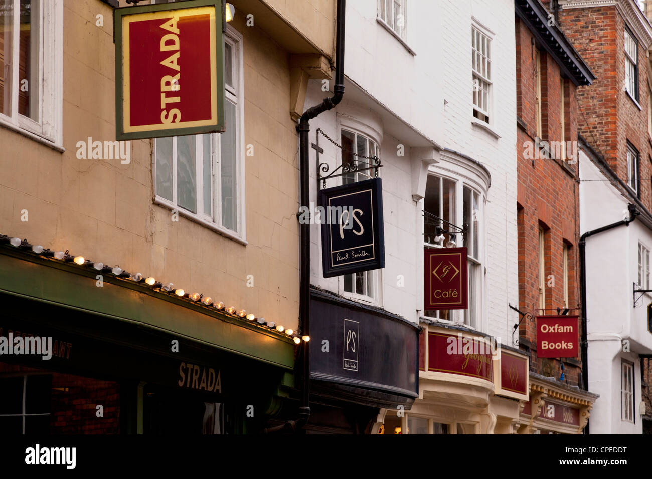 Shops and restaurants in Low Petergate, York, England. - Stock Image