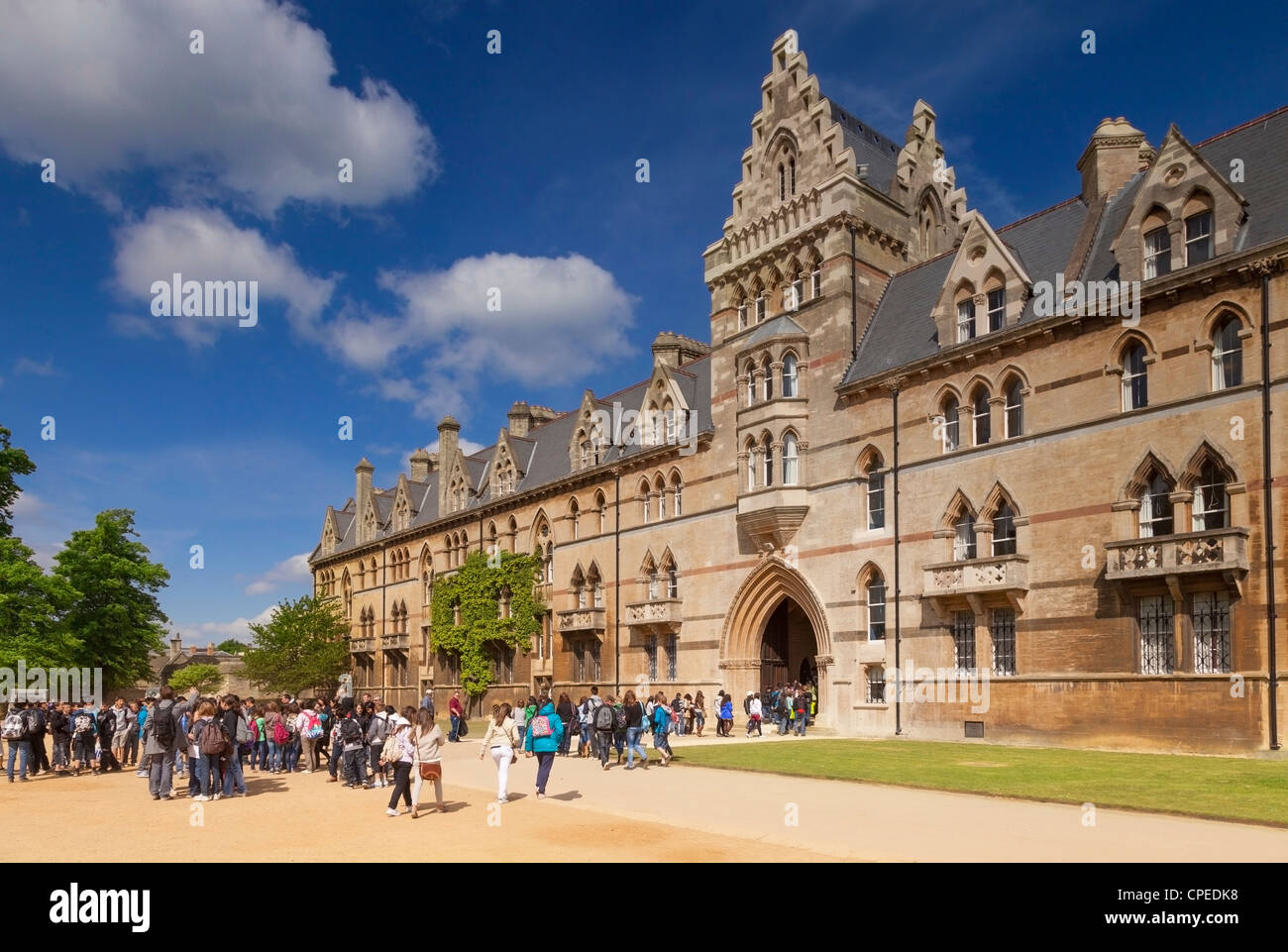Tourists entering the Meadow Building at Christ Church College, Oxford. - Stock Image